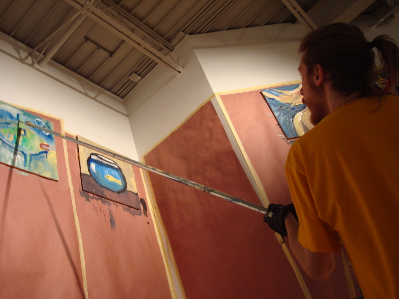 Billy painting with a ten foot pole.