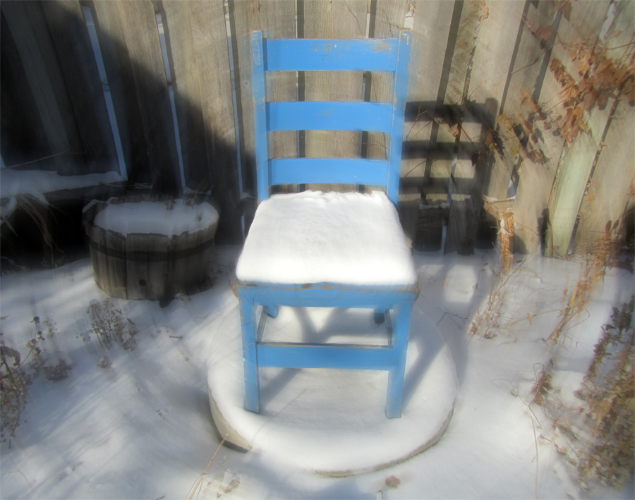 blue chair with snow